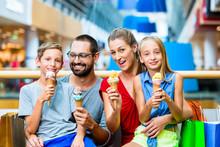 Family Eating Ice Cream In Sho...