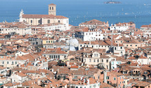 Venice, Italy, Red-tiled Roofs Of The Houses And The Church