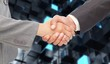 Composite image of handshake between two business people