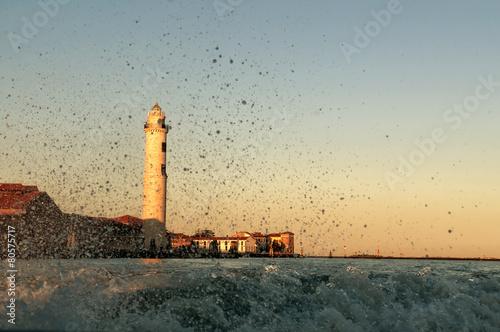 Montage in der Fensternische Leuchtturm Water splash with lighthouse background