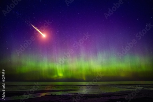 Photo  Falling comet and Aurora Borealis
