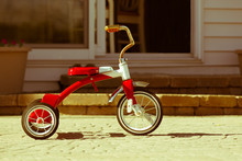 Child's Rusted Red Tricycle Standing Ready