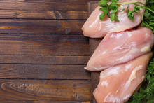 Raw  Chicken Meat  On Wooden T...