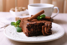 Tasty Piece Of Chocolate Cake With Mint And Cinnamon