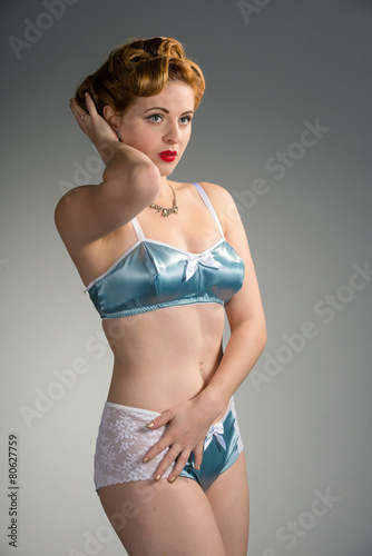 003e21743 Beautiful redhead with vintage hairstyle in blue satin lingerie ...