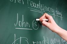 Teacher Hand Writing Grammar S...