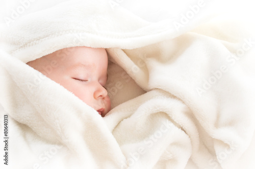 Baby sleeping covered with soft blanket Poster