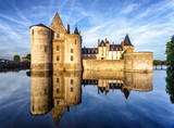 Chateau of Sully-sur-Loire, France. Old medieval French castle on river at sunset in summer.