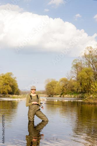 Printed kitchen splashbacks Fishing woman fishing in the river in spring