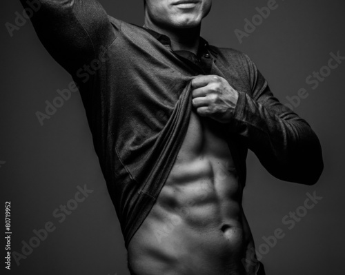 Fashionable guy with muscular body posing Canvas Print