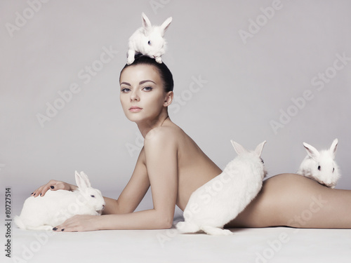 Beautiful woman with rabbit Canvas-taulu