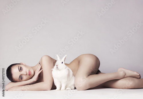 Valokuva  Beautiful woman with rabbit