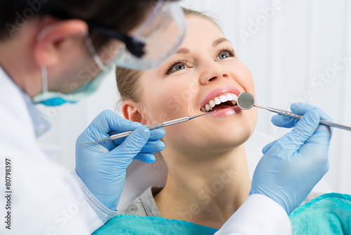 Fototapety, obrazy: Male dentist examining patient teeth before oral operation