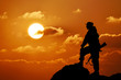 Silhouette of military soldier officer with weapons, sunset