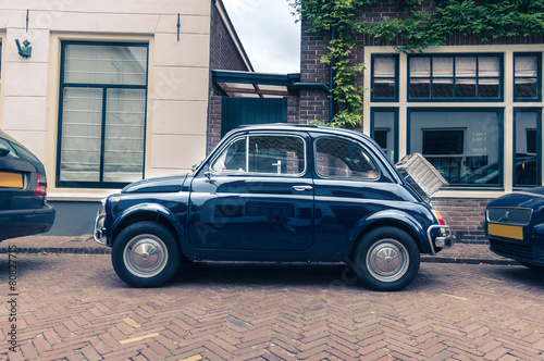 Parked retro car on the street in Europe #80827715