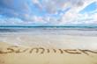 Summer word written on sand