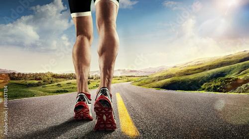 Sports background. Runner feet running on road closeup on shoe.