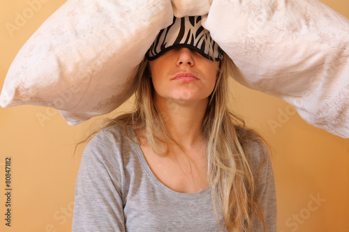 Fotografie, Obraz  Sleepy young women with pillow and sleeping eye mask still on.