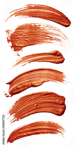 Strokes of bronze paint