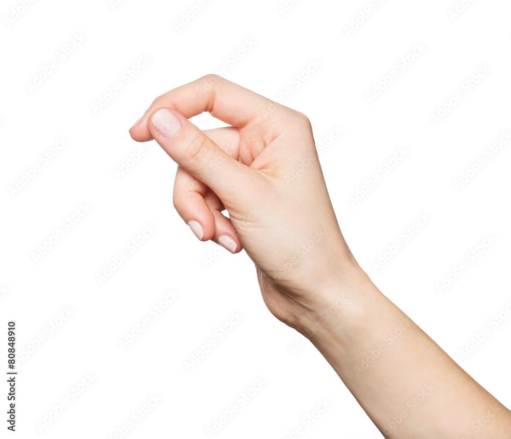 Fototapeta Woman's hand holding something, isolated on white