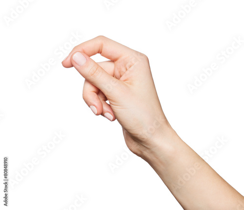 Obraz na płótnie Woman's hand holding something, isolated on white