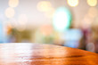 Empty round table top at coffee shop blurred background with bok