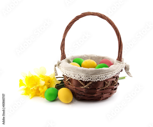 Narcissus Easter eggs, basket with narcissus isolated on white background