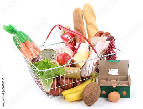 Poster Metal shopping basket with groceries isolated on white