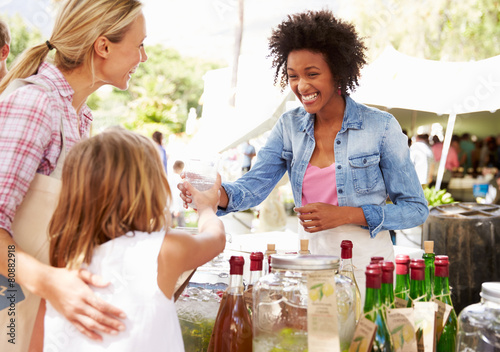 Fototapeta Woman Selling Soft Drinks At Farmers Market Stall