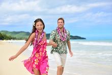Fun Couple On Beach Vacations In Hawaiian Clothing
