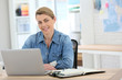 Businesswoman working from home on laptop