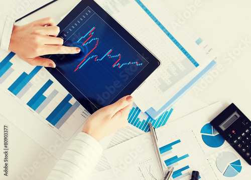 woman with tablet pc and chart papers Canvas Print