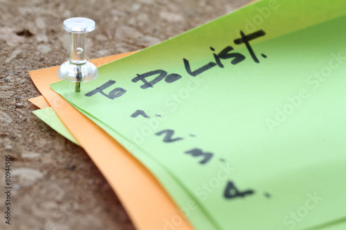 Photo  close up on pin and to do list word on sticky note with cork boa