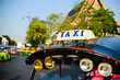 tuk-tuk taxis in Bangkok. Shallow depth of field with the neares