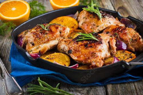 Keuken foto achterwand Kip Roasted chicken with oranges and herbs