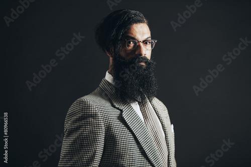 Photo  Formal Guy with Long Facial Hair Looking at Camera