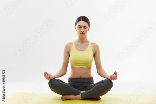 Poster School de yoga Yoga. Woman Meditating and Doing Yoga Against White background