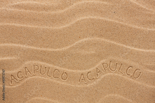 Fotografija  Acapulco  inscription on the wavy sand