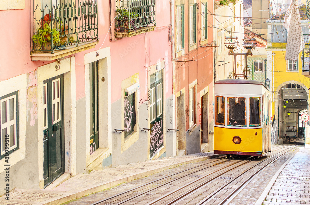 Fototapety, obrazy: Traditional yellow trams on a street in Lisbon, Portugal