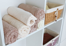 Rolled Towels With Wicker Bask...