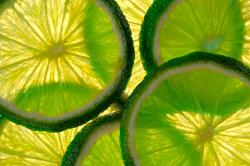 FototapetaGreen lime overlapped slices close-up background.