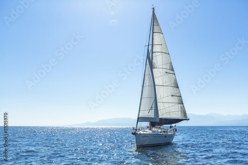 Sailing ship yachts with white sails in the open Sea. Canvas Print