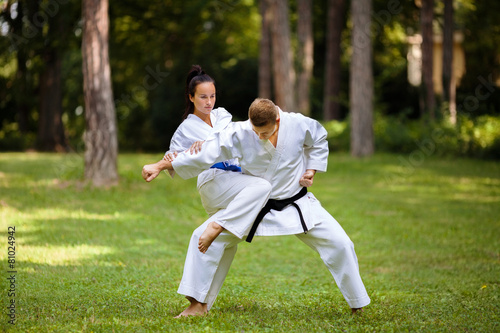 Staande foto Vechtsport Two young Martial Arts fighters practicing in nature