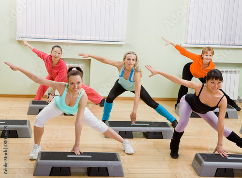 Fotografie, Obraz  Women of Different Age Doing Step Aerobics in the Gym