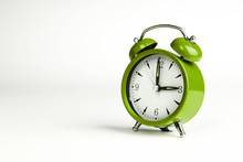 Three O'clock. Green Classic Clock On White Background.