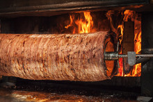 Turkish Doner Kebab Is Preparing In An Oven With Open Fire