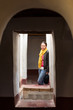 One ansian lady stands at the skylight of Kasbah de Taourirt