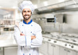 canvas print picture - Smiling chef in his kitchen