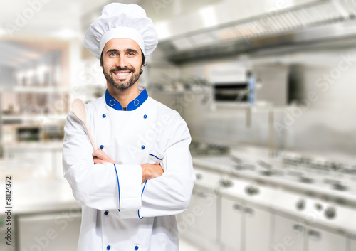 Photo  Smiling chef in his kitchen
