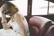 canvas print picture - Elegant woman in vintage car